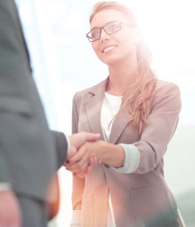 Photo pour Business partners shaking hands in the modern office - image libre de droit