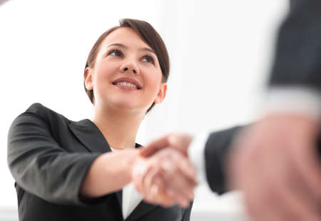 Photo for closeup of business woman shaking hands with her business partner. - Royalty Free Image