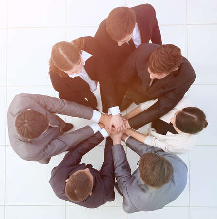 Photo pour view from the top.business team holding hands. - image libre de droit