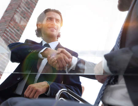 Photo for bottom view. confident handshake of business partners - Royalty Free Image
