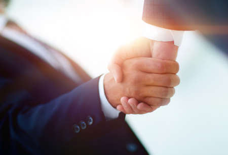 Photo for Shake hands, agreed to between the two men in the businesses. - Royalty Free Image