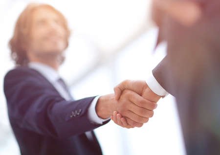 Photo for Two businessman shaking hands greeting each other - Royalty Free Image