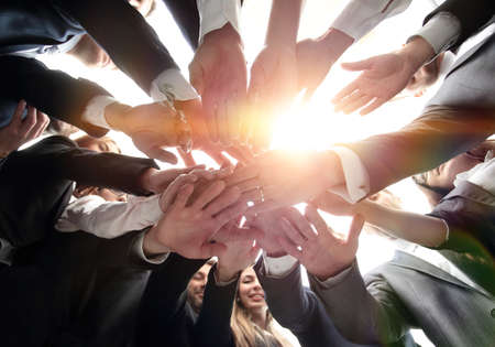 Photo pour large business team is forming a circle and his hands clasped together - image libre de droit