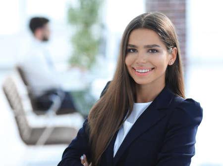 Foto de young business woman on the background of the office - Imagen libre de derechos