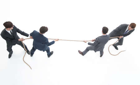 Photo for top view.a tug of war between business teams - Royalty Free Image
