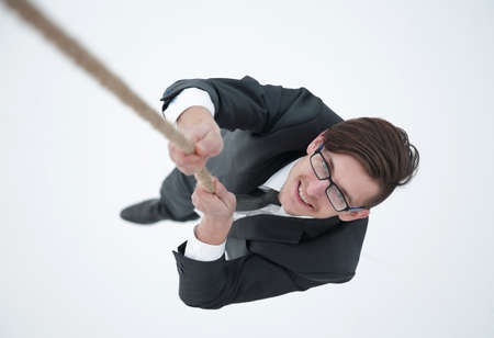 Photo for successful businessman climbing the rope - Royalty Free Image