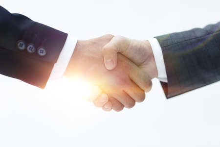 Photo for Closeup of business people shaking hands over a deal - Royalty Free Image