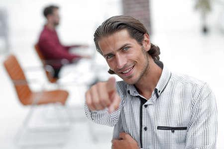 Foto de successful man pointing his finger forward. - Imagen libre de derechos