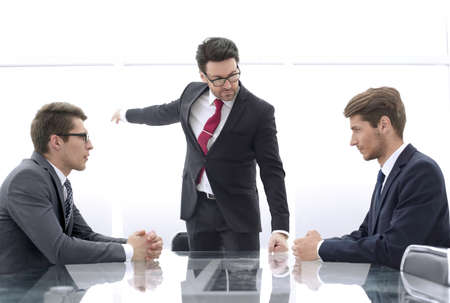 Photo for angry boss points an incompetent employee to the doo - Royalty Free Image