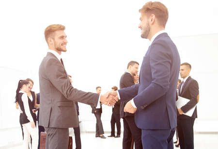 Photo for handshake of business partners on the background of business team - Royalty Free Image