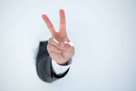 Photo for businessman hand showing a gesture of victory - Royalty Free Image