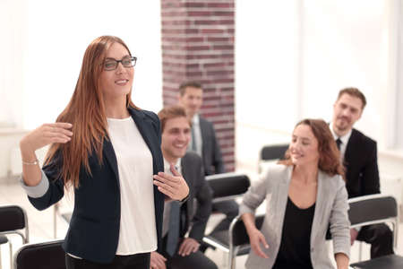 Photo for business woman while asking questions during seminar - Royalty Free Image