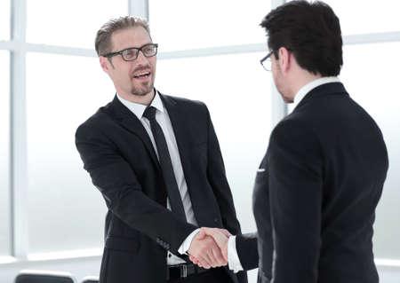 Foto de congratulating colleague with promotion - Imagen libre de derechos