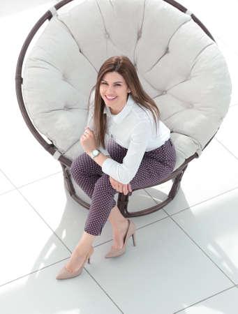 Photo pour top view.young woman sitting in soft round chair - image libre de droit