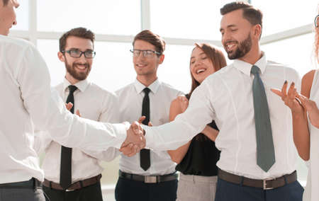 Photo for happy business team the team applauds business partners - Royalty Free Image