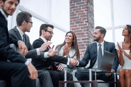 Photo for colleagues applaud business partners at a business meeting - Royalty Free Image