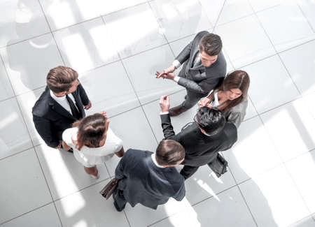 Photo for top view. employees discussing work issues - Royalty Free Image