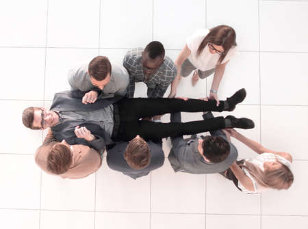 Photo for top view.a fun business team is rocking their boss - Royalty Free Image