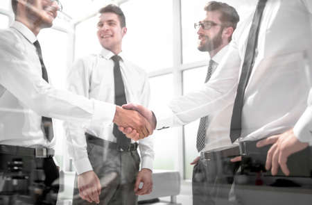 Photo for business colleagues shaking hands in the office - Royalty Free Image