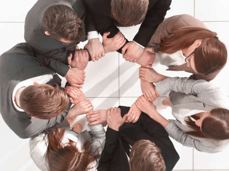 Foto de top view. business team forming a circle - Imagen libre de derechos