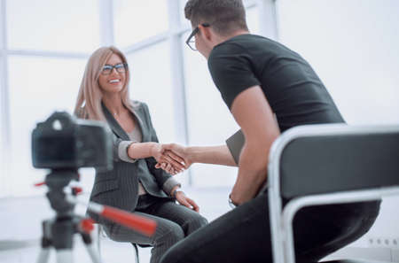 Photo for interviewer welcomes the guest to the Studio - Royalty Free Image