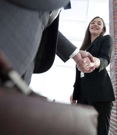 Photo for Close up of businessman and businesswoman shaking hands - Royalty Free Image