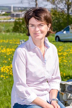 Photo pour Farmer at the conveyor belt - image libre de droit
