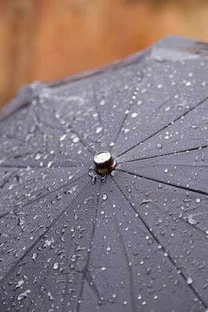 Closeup view of a wet umbrella on a rainy day