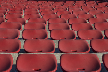 Photo for Empty plastic red chairs In outdoor theater  in sunny day. Close Up. - Royalty Free Image