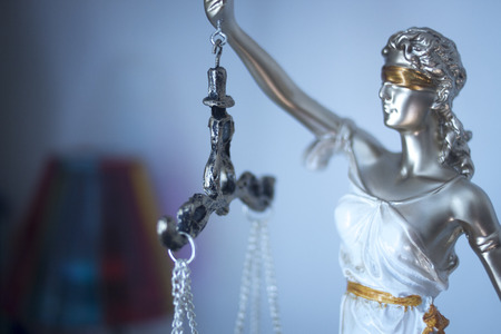 Photo pour Lawyers legal blind justice bronze statue Themis and scales in attorneys law firm offices. - image libre de droit