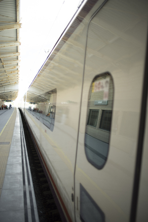 Foto per High speed modern bullet passenger train in station by platform in Spain. - Immagine Royalty Free