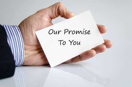 Photo pour Bussines man hand with text Our promise to you - image libre de droit