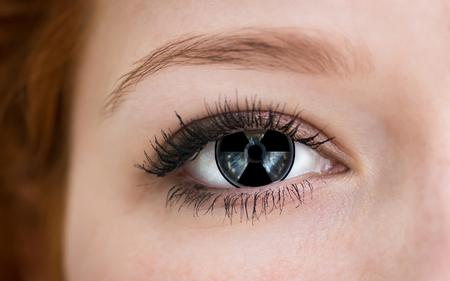 Foto de Human eye with radiation hazard symbol - concept photo. - Imagen libre de derechos