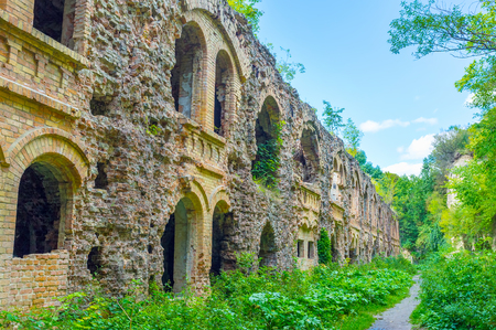 Photo for Tarakanov Fort is a famous defensive building, nowadays lies in ruins surrounded by lush greenery, Dubno, Ukraine - Royalty Free Image