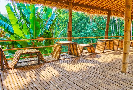 Foto de The shady bamboo terrace with tables in benches located atop the hill in Mae Fah Luang garden, Doi Tung, Thailand - Imagen libre de derechos