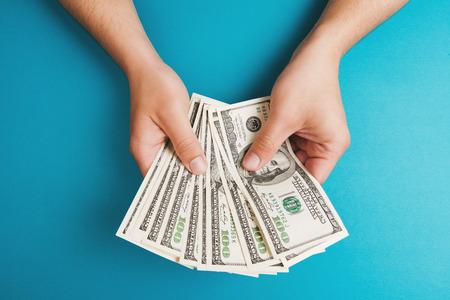 Photo pour Man counting money, economy concept, allocation of money - image libre de droit