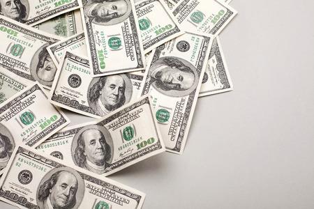Foto de money american hundred dollar bills - horizontal on grey background - Imagen libre de derechos
