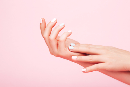 Foto de Tender hands with perfect manicure - Imagen libre de derechos