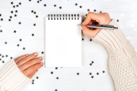 Photo pour Festive decorations and notebook - image libre de droit