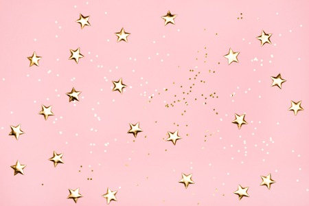 Photo for Golden stars glitter on pink background. - Royalty Free Image