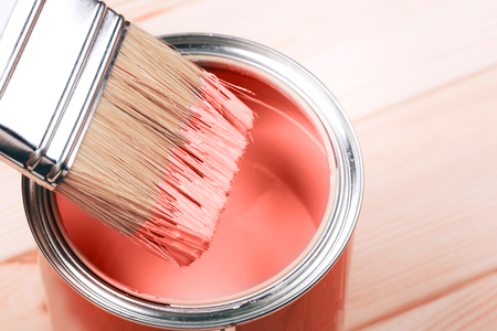 Foto de Brush with Living Coral paint on wooden background. Color of the year 2019. Main trend concept. - Imagen libre de derechos