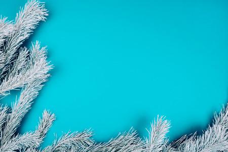 Photo pour Snowy fir branches on blue background. Christmas and winter concept. - image libre de droit