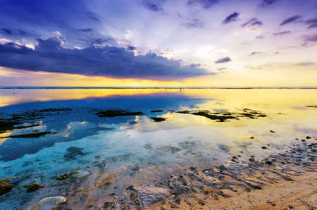 Photo for Tropical sunset at low tide. Gili Travangan island, Lombok, Indonesia. - Royalty Free Image