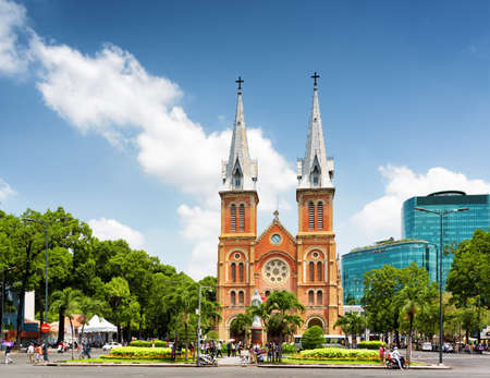 Photo for Saigon Notre-Dame Cathedral Basilica (Basilica of Our Lady of The Immaculate Conception) on blue sky background in Ho Chi Minh city, Vietnam. Ho Chi Minh is a popular tourist destination of Asia. - Royalty Free Image