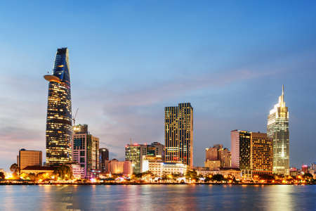 Photo pour Ho Chi Minh City skyline and the Saigon River at sunset. Wonderful view of skyscraper and other modern buildings at downtown. Ho Chi Minh City is a popular tourist destination of Vietnam. - image libre de droit