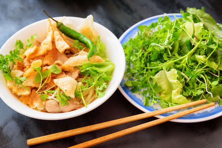 Photo for Cao Lau in street cafe of Hoi An (Hoian) at Quang Nam Province of central Vietnam. Cao Lau is a regional Vietnamese dish made with noodles, pork and local greens. Cao Lau is found only in Hoi An. - Royalty Free Image