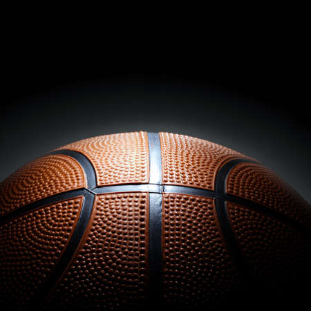 Photo of basketball on black background.