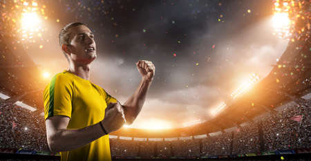 Happy soccer player with a goal joy in the 3d imaginary stadium background.The imaginary soccer stadium is modeled and rendered.