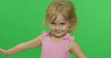 Foto de Pretty girl in pink swimsuit. Portrait close up. Cute little blonde child, 3-4 years old. Summer vacation concept. Green screen. Chroma Key - Imagen libre de derechos