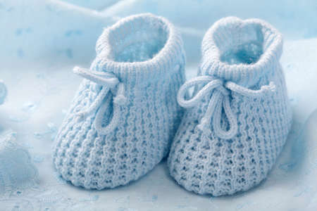 Photo for Blue baby booties on blue background - Royalty Free Image